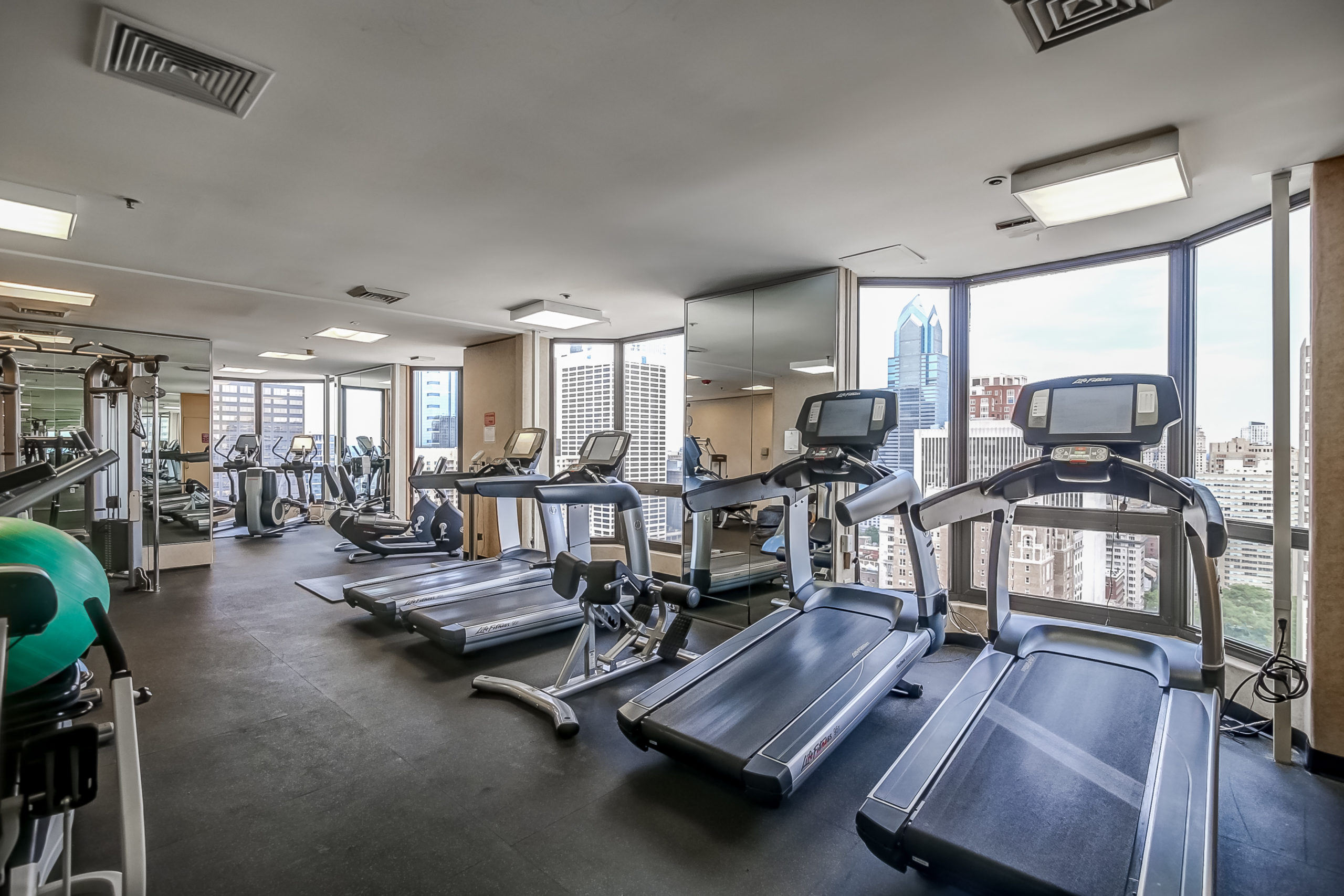 rooftop fitness center with a Philadelphia city view