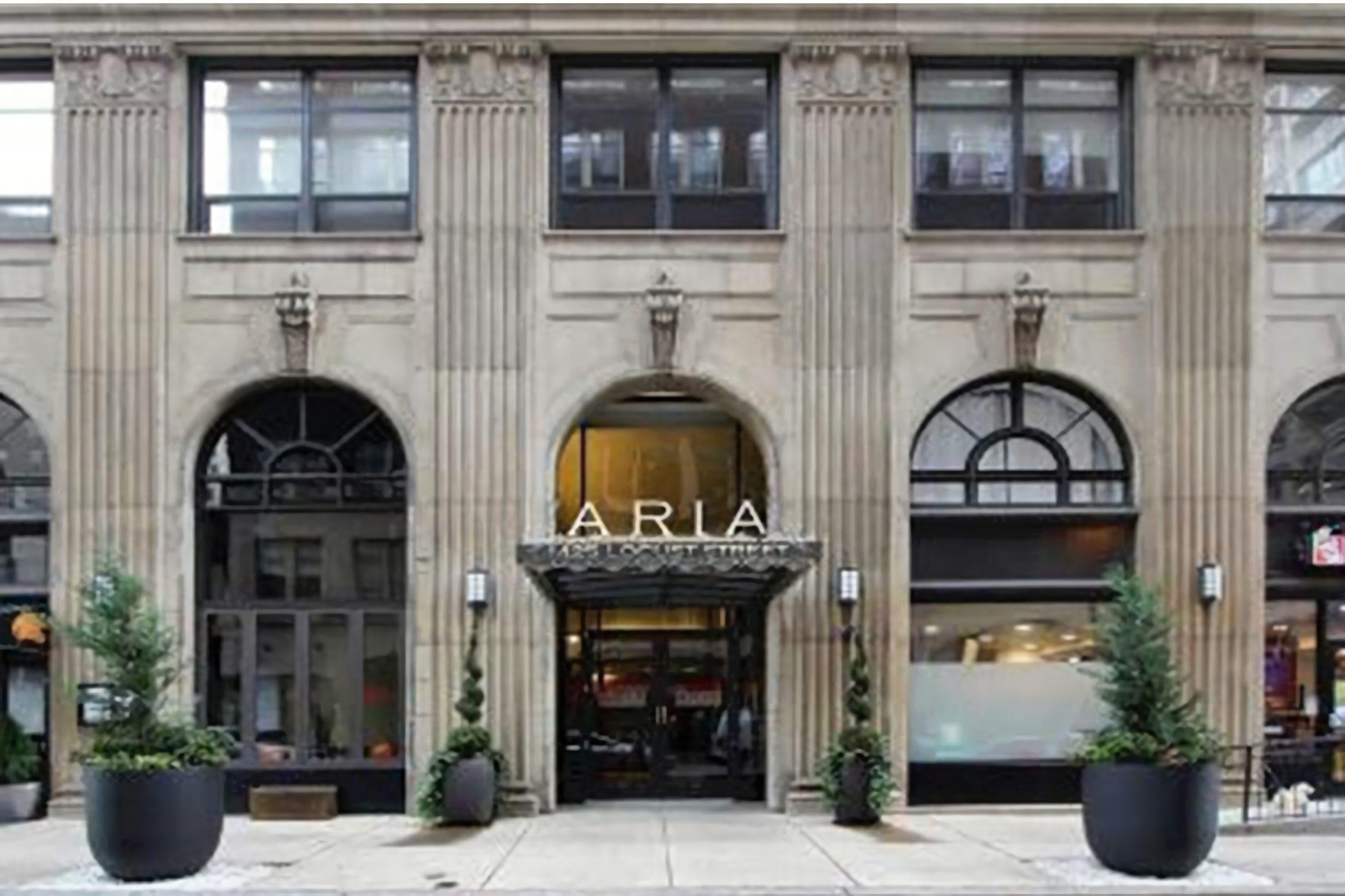 Exterior of The Aria luxury condo building